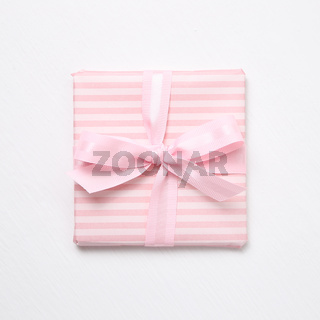 Pink striped pattern gift box isolated on white background