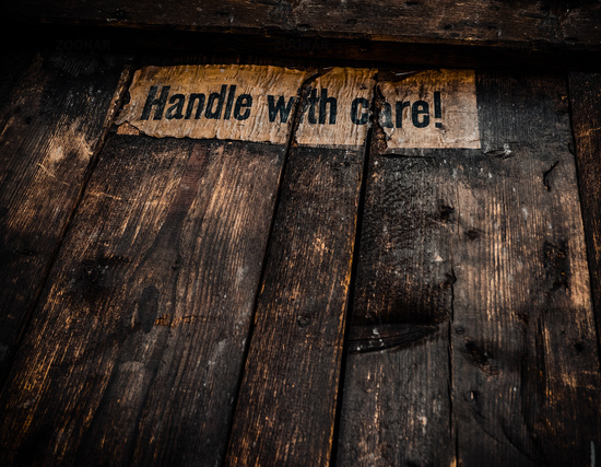 Grungy Handle With Care Sign