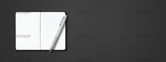 Black open lined notebook with a pen isolated on dark background. Horizontal banner
