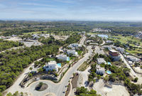 Aerial panoramic image Las Colinas golf course and modern luxury villas. Spain