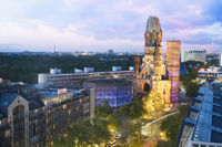 Elevated view of Kaiser Wilhelm Memorial Church at dusk.