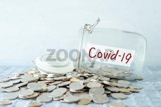 Money jar with covid19 label
