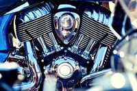 Chrome motorcycle engine close up view, full frame background