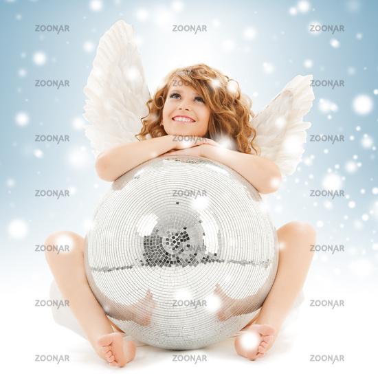 happy teenage angel girl with disco ball