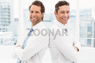 Confident happy businessmen in office