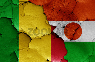 flags of Mali and Niger painted on cracked wall
