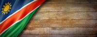 Namibian flag on vintage wood wall banner