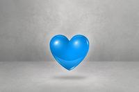 3D blue heart on a concrete studio background
