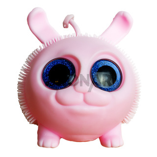 Pink round rubber toy with big round blue eyes on an isolated background