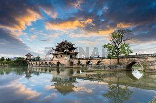 yunnan double dragon bridge in sunset