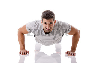 Handsome young man making pushups