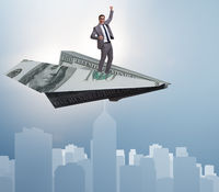 Businessman flying on paper plane in business concept