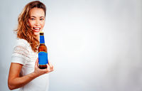 smiling woman with bottle