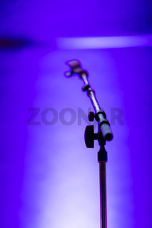 Empty microphone stand on a stage