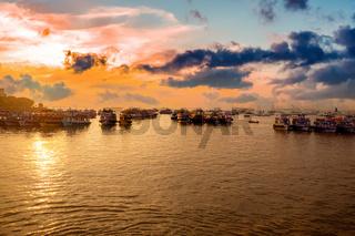 Boats on Mumbai water at dawn. Colaba region of Mumbai, Maharashtra, India.