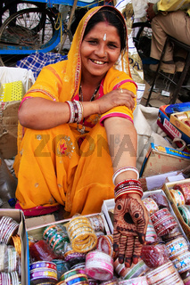 Indian woman showing henna painting, Sadar Market, Jodhpur, India