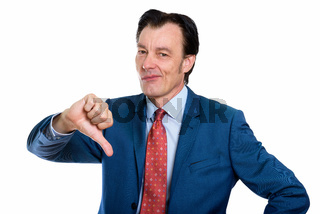 Studio shot of stressed mature businessman giving thumbs down