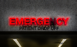 Rundown Hospital ER Drop Off Sign