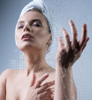 Young girl enjoying water splashes on her face