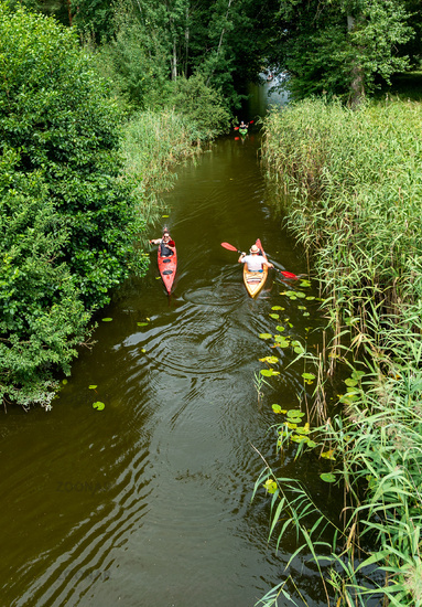 kayakers paddle along the canals from one lake to another in Zwenzow