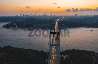 View over Istanbul bridge over Bosphorus Ocean with Car traffic at Dusk Sunset, Aerial perspective from above