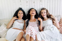 Laughing happy women have fun relax together at home