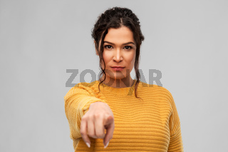 young woman pointing finger to camera