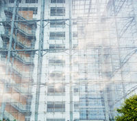 Architectural background of a modern high-rise building with a clear glass facade
