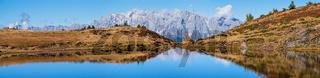 Autumn alpine Kleiner Paarsee or Paarseen lake, Land Salzburg, Austria. Alps Hochkonig rocky mountain group view in far.