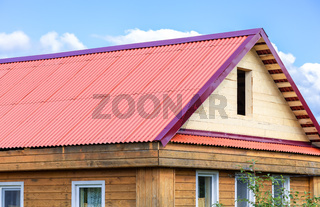 Wooden country house with a new triangular roof