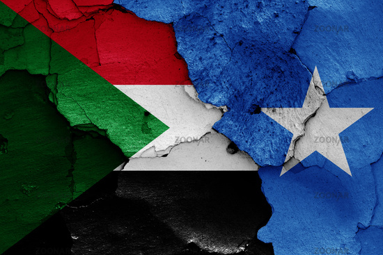 flags of Sudan and Somalia painted on cracked wall