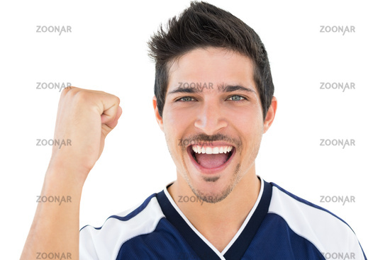 Close up portrait of football player cheering