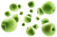 Green apples levitate on a white background