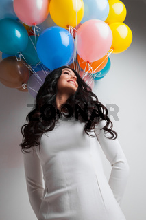 Woman with color balloons