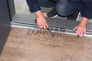 Woman in laying a laminate floor