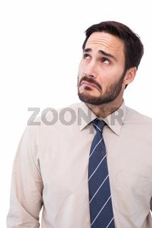 Portrait of a nervous businessman looking up