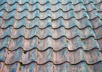a full frame image of traditional old terracotta curved overlapping pantile roof tiles