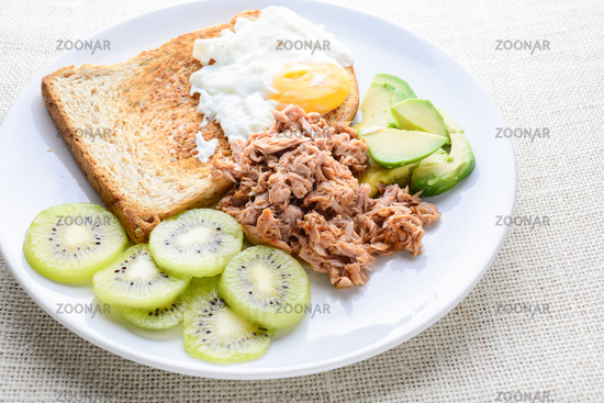 Modern style clean food, bread, egg, tuna salad, kiwi and avocado
