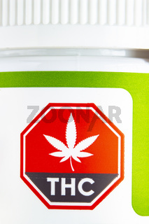Calgary, Alberta, Canada. Sep 02, 2020. Macro close up of the Standardized Cannabis Symbol on green cannabis container.
