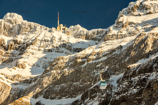 The mountain Saentis with summit station and aerial tramway in the Swiss Alps