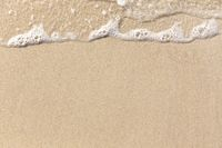Beach Sand and soft wave background texture
