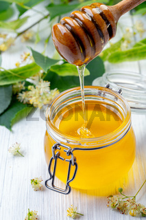Fresh organic honey and linden blossoms.