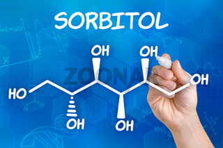Hand with pen drawing the chemical formula of sorbitol