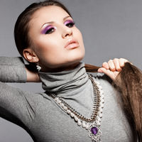 elegant fashionable woman with violet visage