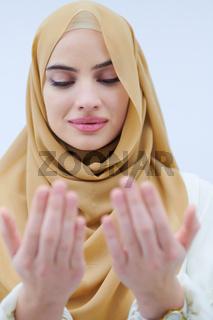 muslim woman making traditional prayer to God