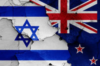 flags of Israel and New Zealand painted on cracked wall