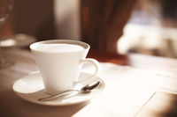 Cup of coffee on cafe table