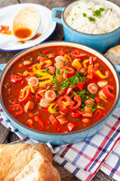 Spicy sausage stew with bell peppers