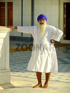 Indian man standing at Gurudwara temple, Pushkar, India