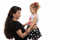 Mom and four-year-old daughter look at each other with fun